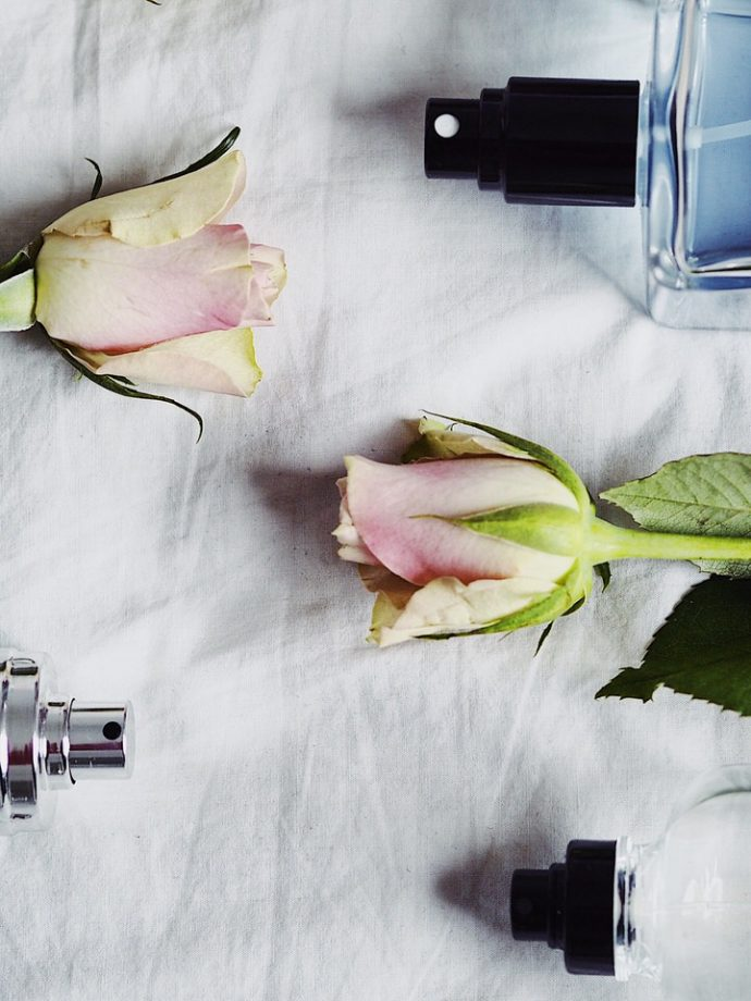 Fragrance-bottles-and-roses-on-the-bed-The-FT-Times-Blog